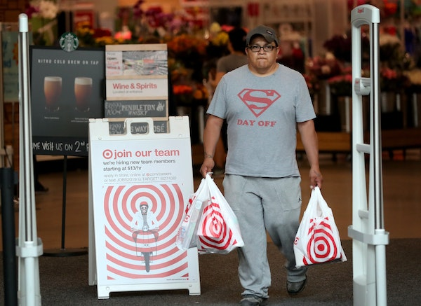 A shopper left the Nicollet Mall Target in downtown Minneapolis on Saturday, a day when many reported long waits to check out. The retailer also repor