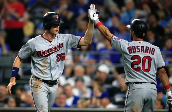 The Twins' Max Kepler is congratulated by Eddie Rosario after scoring during the seventh inning