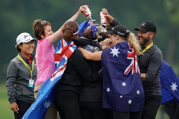Hannah Green was mobbed on the 18th hole Sunday by fellow Australians — including Hall of Famer Karrie Webb, second from left — after winning the