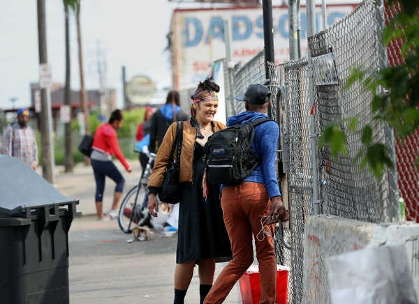 Ricky Robinson-Myers, 30, right, who was a long-time resident of the homeless encampment and lived at the Navigation Center up until a few days ago, t