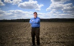 Grain fraud investigator John Bobbe stood for a portrait on his farmland in Scandinavia, Wis. ] Aaron Lavinsky ¥ aaron.lavinsky@startribune.com Organ