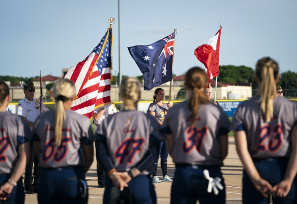 The Australian and American stars and stripes waved before the Aussie Peppers and Canadian Wild met in fastpitch softball earlier this month in North