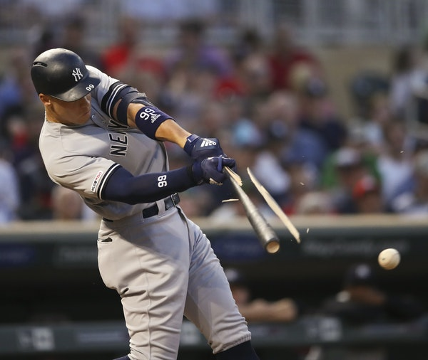 The bat of the Yankees' Aaron Judge splintered in the fourth inning, but he got enough wood on the pitch to single to center at Target Field on Wedn