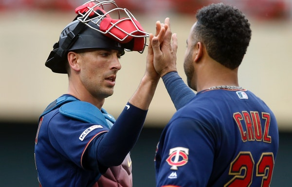 Twins catcher Jason Castro and designated hitter Nelson Cruz high-fived after they defeated the Rangers 7-4 at Target Field on Saturday.