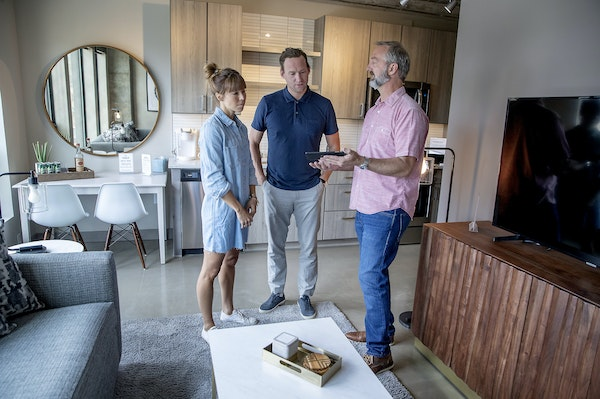 Minnestay's Lance Bondhus, right, talked with potential buyers Sophie Rupp and Harrison Wagenseil at the Sable in the North Loop.