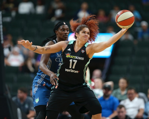 New York Liberty center Amanda Zahui B., a former Gophers player, reached for a pass while defended by Lynx center Sylvia Fowles during a game in 2017
