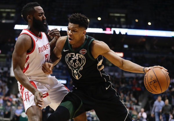 Among the 2019-20 NBA season openers is a matchup of the two most recent NBA MVPs, Milwaukee's Giannis Antetokounmpo, right, and Houston's James H