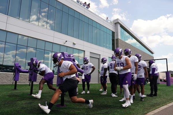 Vikings defensive players ran drills during training camp.