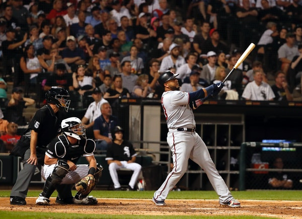Nelson Cruz watches his two-run home run during the fifth inning