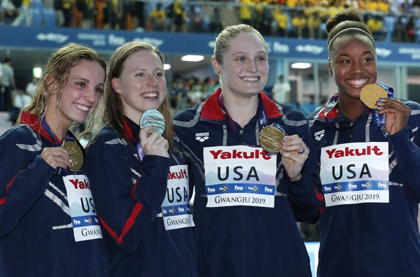 The United States women's 4x100m medley relay team (from left, Lakeville's Regan Smith, Lilly King, Kelsi Dahlia and Simone Manuel) posed with their g