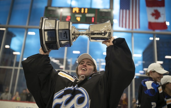 Minnesota Whitecaps goaltender Amanda Leveille celebrated with the Isobel Cup at Tria Rink on March 17 after a 2-1, overtime victory over the Buffalo