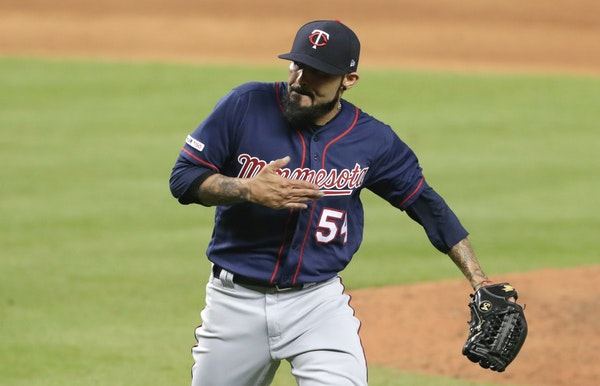 New Twins reliever Sergio Romo pounded his chest after striking out former teammate Martin Prado to end the eighth.
