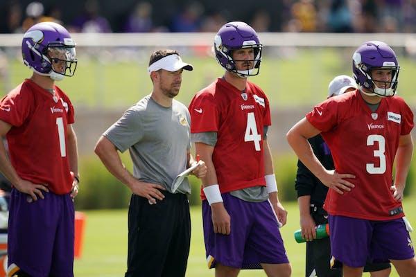 Vikings backup quarterbacks Kyle Sloter (1), Sean Mannion (4) and Jake Browning (3) gathered with quarterbacks coach Klint Kubiak to watch drills duri