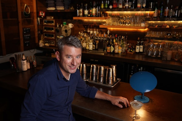Minnesotan Nick Fauchald, a James Beard Award-winning author, with a daiquiri at one of his favorite local bars, the Back Bar at Young Joni in northea