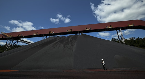 A mountain of direct-reduced-grade iron pellets is ready to ship from Cleveland-Cliffs' Northshore Mining plant in Silver Bay.