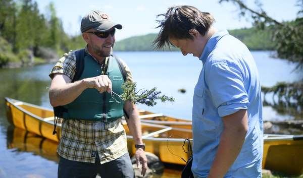 Tony Jones baptized his 14-year old son, Aidan, as a neophyte voyageur at the completion of the Height of Land Portage in the BWCA. ] Aaron Lavinsky �