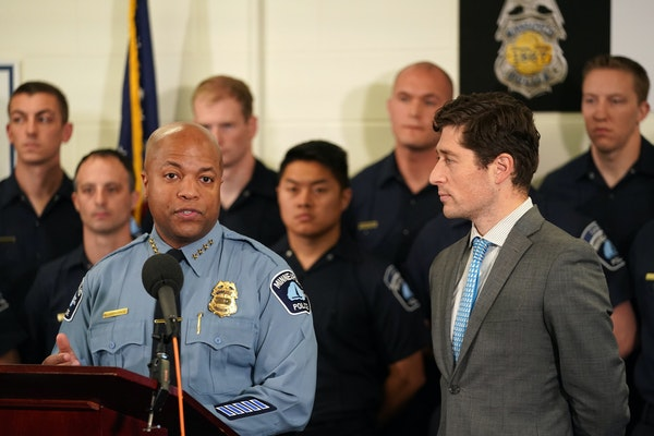Minneapolis Mayor Jacob Frey, right, said he will seek more officers, but not necessarily the 400 that Police Chief Medaria Arradondo has called for.