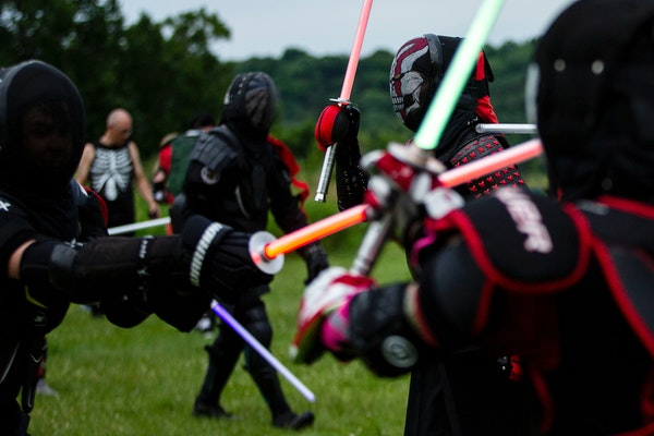 In an all-day series of melees at Afton State Park last month, nearly 50 people battled with LED sabers, wearing repurposed sports gear as armor. The