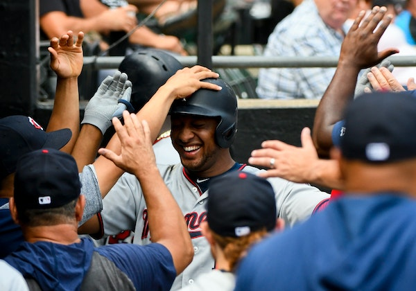 The Twins' Jonathan Schoop, center, got welcomed back to the dugout after his two-run home run in the fifth inning -- one of the team's four homers --