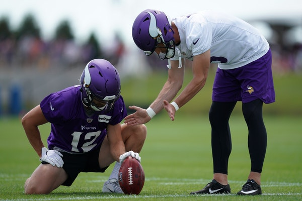 Minnesota Vikings wide receiver Chad Beebe (12) and kicker Dan Bailey (5) worked together on ball placement during training camp Friday.