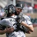 Chicago White Sox pitcher Lucas Giolito celebrates his complete game shut-out with catcher James McCann.