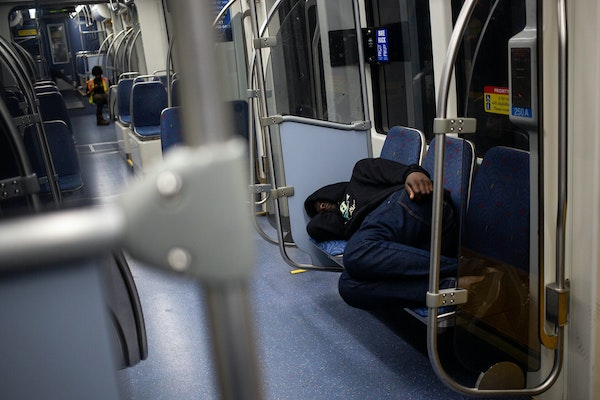 A man sleeps on the Green Line train early in the morning Friday, August 16, 2019. ] NICOLE NERI • nicole.neri@startribune.com