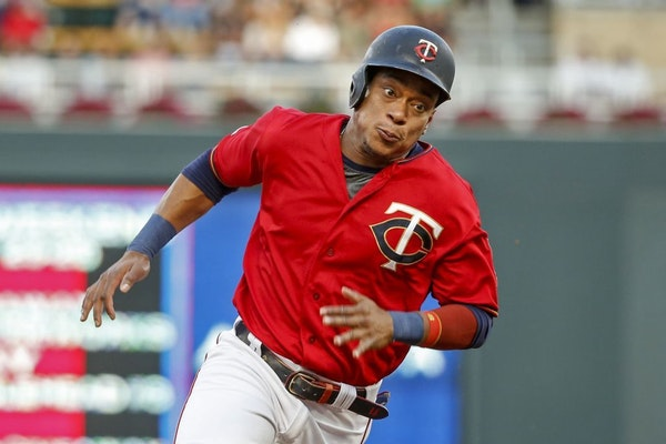 Minnesota Twins' Jorge Polanco rounds third base en route to scoring against the Chicago White Sox on a single by Nelson Cruz in the first inning of a