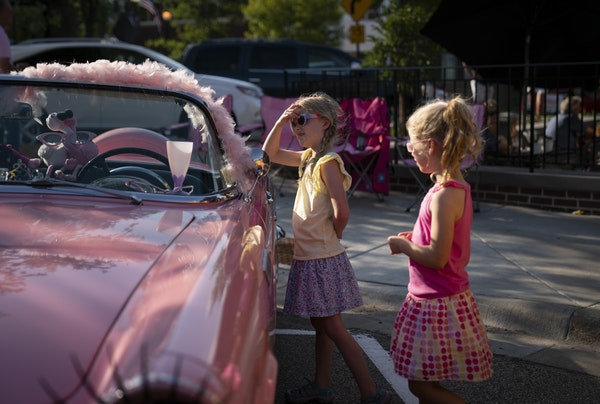 Avery and her sister Katilyn, of Victoria, checked out a pink Thunderbird during Classic Car Night in downtown Victoria.
