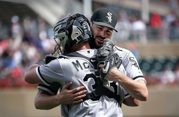 Chicago White Sox pitcher Lucas Giolito celebrates his complete game shutout with catcher James McCann