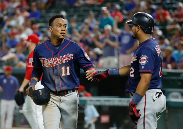 Twins infielders Jorge Polanco (11) and Luis Arraez (2) celebrated after Polanco scored during the eighth inning Saturday night.