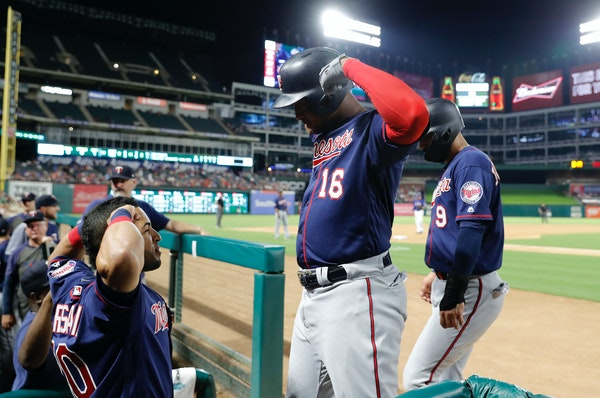 The Twins' Eddie Rosario, left, and Jonathan Schoop celebrated Schoop's two-run home run in the seventh inning. Friday.