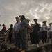 Cowboys found a trailer to get a better view of the bullring at the third annual Jaripeo at the Rice County Fairgrounds.