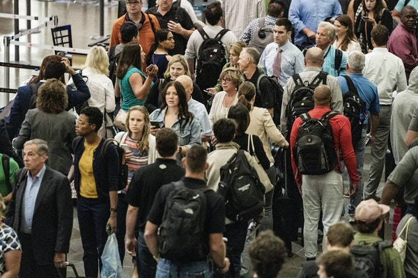 Lines were long at Minneapolis-St. Paul International Airport before 6 a.m. Monday, regardless of whether people were headed to the north or south sec