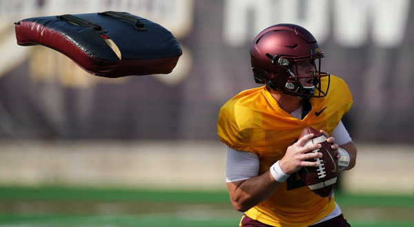 Gophers quarterback Tanner Morgan dodged pads thrown at him during a drill at practice Friday.