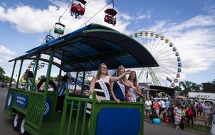 Princess Kay of the Milky Way finalists waved to fans during the daily parade Thursday at the Minnesota State Fair.
