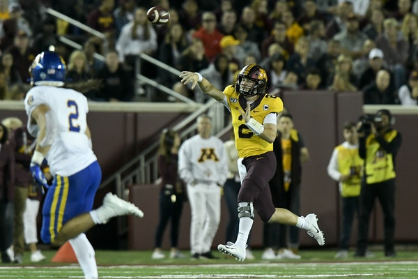 Gophers quarterback Tanner Morgan passed for a first down in the second quarter of Thursday's 28-21 victory over South Dakota State.