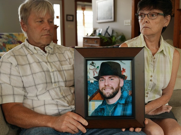 In 2019, Matthew Klaus' parents John and Denise Klaus held a portrait of their deceased son at their home in Oronoco.