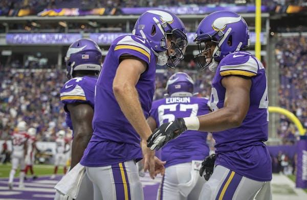 Vikings running back Khari Blasingame and quarterback Kyle Sloter celebrated a 15-yard touchdown against Arizona.