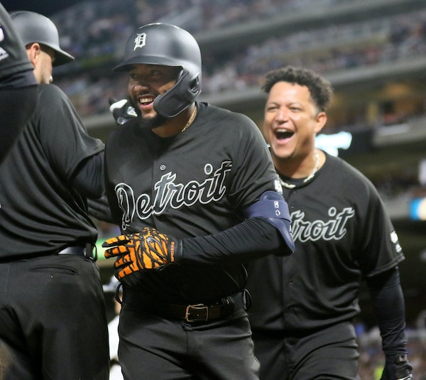 Ronny Rodriguez celebrated his sixth-inning grand slam with teammates including Miguel Cabrera, right.