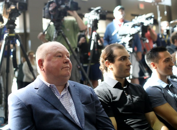Wild coach Bruce Boudreau and players Luke Kunin and Jared Spurgeon watched the press conference introducting general manager Bill Guerin on Thursday