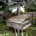 One of Nate Otto's many art pieces in his backyard is an old piano pushed up against a tree and left at the mercy of the elements.