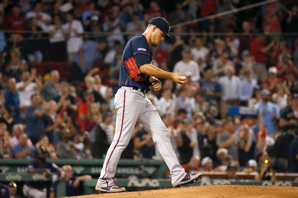 Twins starting pitcher Jose Berrios reacts after giving up a three-run home run to Boston's Mookie Betts during the second inning
