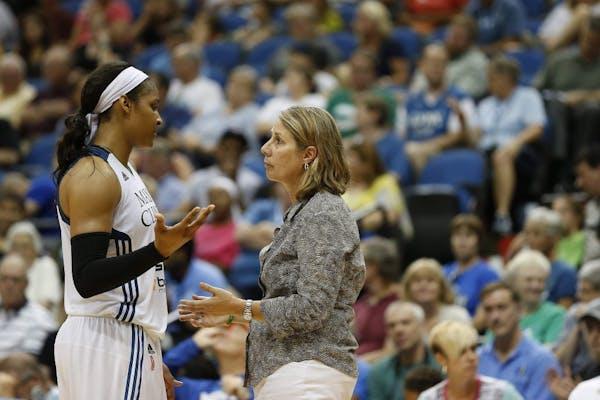 Minnesota Lynx forward Maya Moore (23) talks with head coach Cheryl Reeve during the second half of a WNBA basketball game against the Connecticut Sun