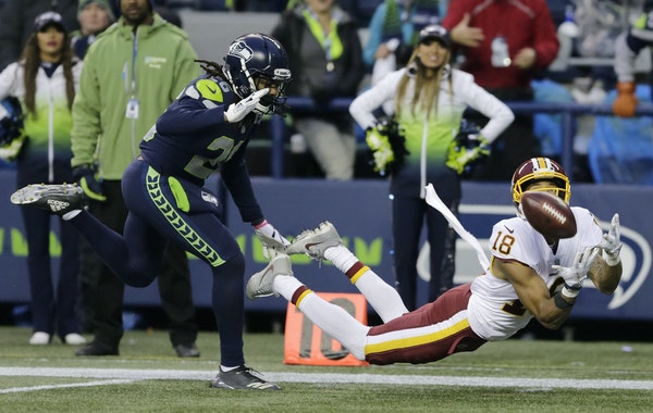 Josh Doctson dived to catch a touchdown pass from Kirk Cousins against Seattle cornerback Shaquill Griffin on Nov. 5, 2017.