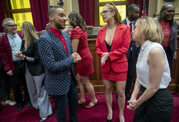 Minneapolis City Council Member Phillipe Cunningham, left, congratulated Ramona Falls, center, and Jayne Swift of the Sex Worker Outreach Project afte
