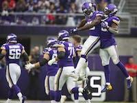 Minnesota Vikings cornerback Xavier Rhodes (29) and s running back Dalvin Cook (33) celebrated a defensive turnover at U.S. Bank Stadium Sunday Septem