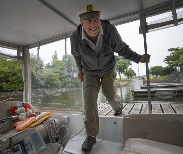 """""""Why isn't there more activity out here?"""" said Cory Parkos, who was prepared his Minneapolis WaterTaxi at Boom Island Marina earlier this month."""