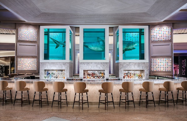 Damien Hirst's sculpture of a 13-foot shark floats atop the Unknown Bar at the Palms Casino Resort.