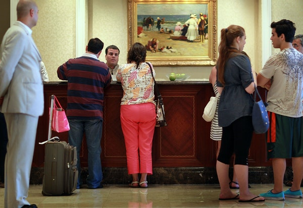 Guests check in at the Ritz-Carlton in Key Biscayne, Fla.