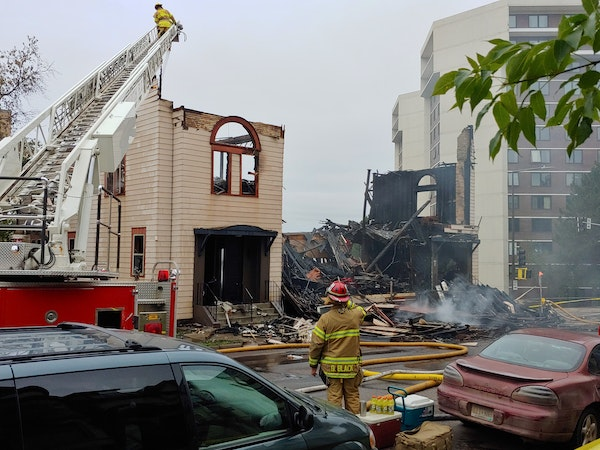 An overnight fire engulfed and destroyed a synagogue in downtown Duluth and continued to burn many hours later Monday morning.